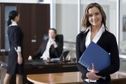 Woman Holding Folder, Risk Management & Litigation Support Based in Bethesda, MD